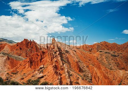 Red canyon, throats of rowers against the background blue sky