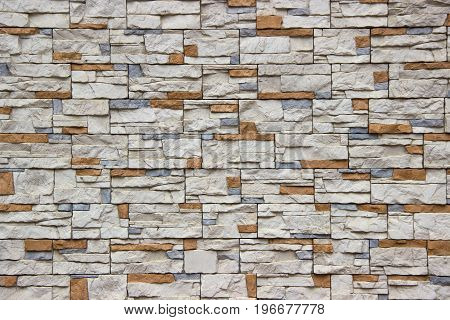 Rustic stone surface in random pattern .
