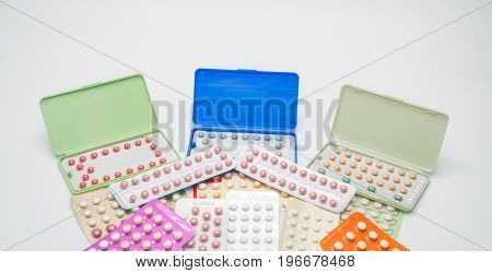 Piles of colorful birth control pills with modern packaging