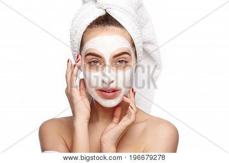 Young model with applied mask on face posing sensually on white.