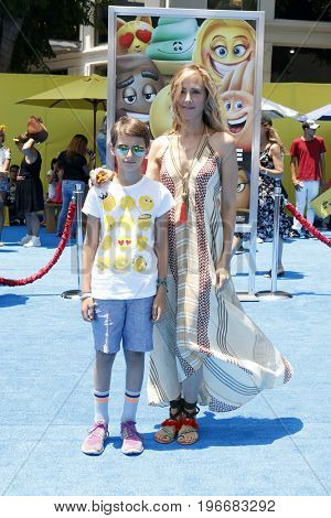 LOS ANGELES - JUL 23:  Kim Raver, Son at