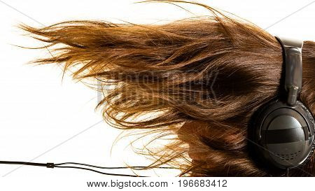 Music devices digital sound concept. Man listening to music on headphones windblown long hair