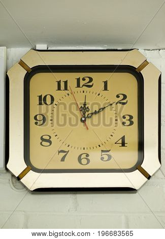 COLOR PHOTO OF ANTIQUE CLOCK MOUNTED ON WALL