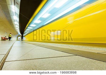 German Subway Yellow Wagon Long Exposure Passing Bend Light Streaks Urban Transportation