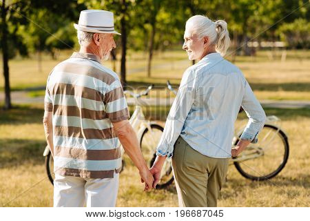 It was my dream. Attractive mature female standing opposite her man and holding his hand while looking into his eyes