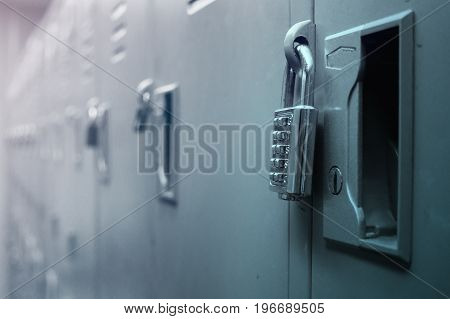 Closeup padlock with key number hanging on locker for concept technology data log security.
