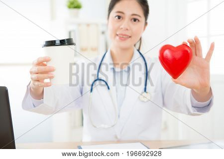 Selective Focus Of Blur Smiling Female Doctor