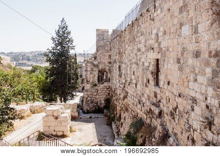 Fragment of the fortress walls and Zion Gate street near to the Zion Gate in the old town in Jerusalem Israel