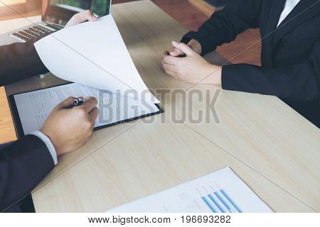 Job interview Young attractive executives man reading her resume work history of applicant in a clipboard colloquy dream Skill expertise experience and businessman listen to candidate answers.