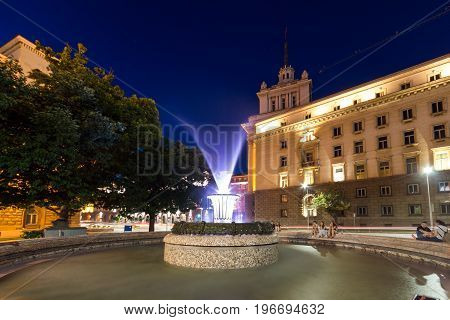 SOFIA, BULGARIA - JULY 21, 2017: Night photo of Fountain in front of The Building of the Presidency and Former Communist Party House in Sofia, Bulgaria