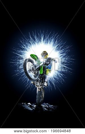 Professional dirt bike rider isolated on the black background