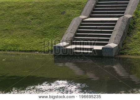 A stone staircase at Lake Stairs lead from a road in the lake below