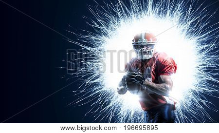 American football player in action isolated on the black background