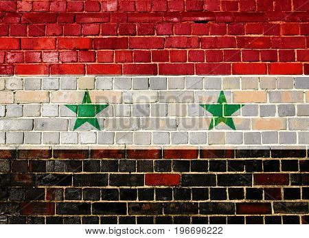 Syrian flag on an old brick wall background