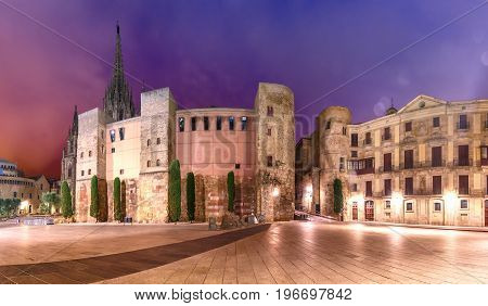 Panorama of Ancient Roman Gate and Placa Nova at night, Barri Gothic Quarter in Barcelona, Catalonia, Spain