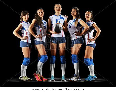 Female professional volleyball players isolated on black background