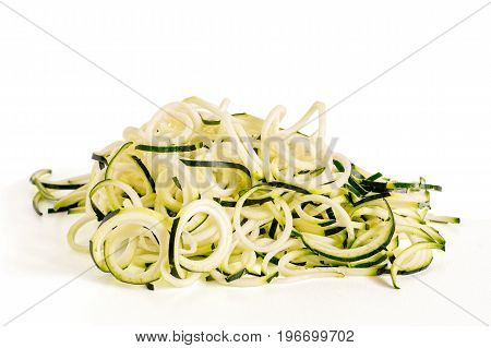 Front view of raw zucchini noodles (zoodles) isolated on white.