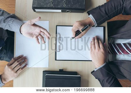 Job interview Young attractive executives man asking questions to applicant about work history colloquy dream Skill expertise experience and businessman listen to candidate answers.
