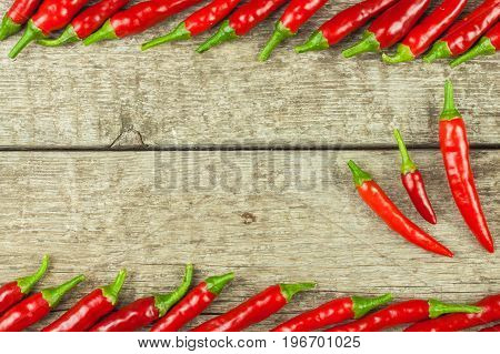 Fresh chili pepper on a wooden board. Growing chili. Healthy spice