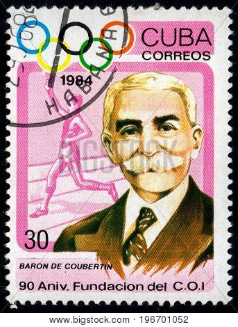UKRAINE - CIRCA 2017: A postage stamp printed in Cuba shows 90th Anniversary of IOC. Baron Pierre de Coubertin from series Summer Olympics Atlanta circa 1984
