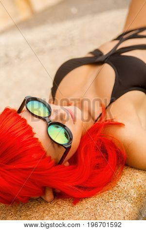 Sexy Lady With Red Hairs Lay Near Swimming Pool.