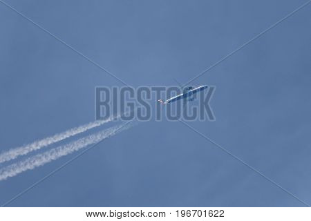 jet with two engines left contrail in the clear sky