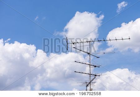 Beautiful blue sky with cloud and antenna
