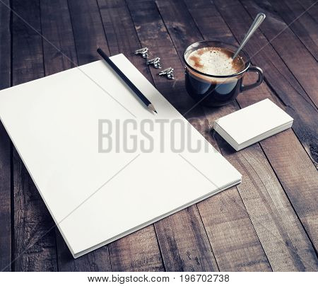 Photo of blank stationery set on vintage wood table background. Mockup for ID. Blank objects for placing your design. Branding identity.
