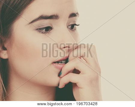 Anxiety stress to much work problem concept. Teenage woman looking worried thinking about something