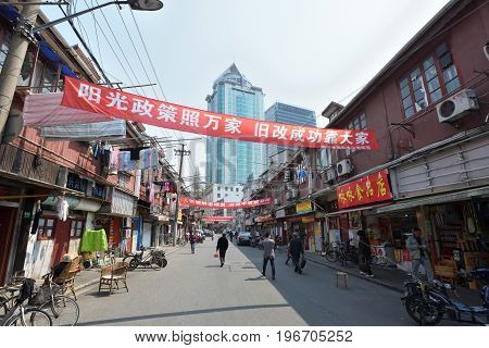 SHANGHAI CHINA - MARCH 26: Shanghai street on March 26 2016 in Shanghai China. Shanghai is the largest Chinese city by population.