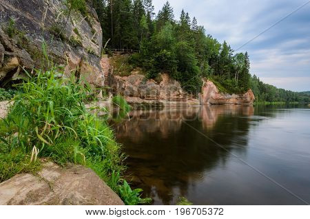 Sandstone outcrops. Erglu Cliffs on the bank of the Gauja river.