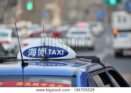 SHANGHAI CHINA - MARCH 25: Taxi car sign on March 25 2016 in Shanghai China. Shanghai is the largest Chinese city by population.