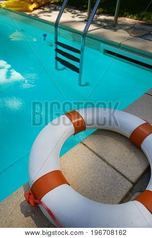 The lifebuoy is located on the edge of the pool
