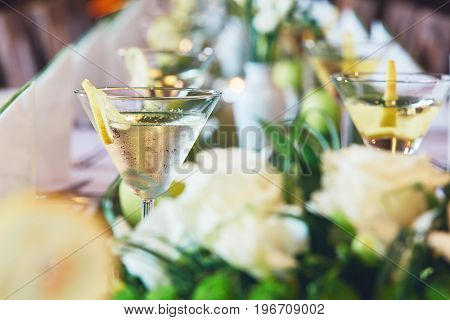 Wedding (birthday) celebrations party. Glasses with an aperitif on a table in a restaurant.