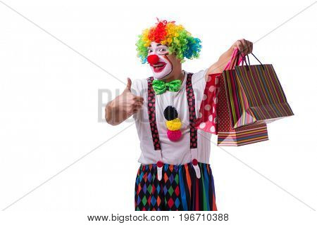 Funny clown after shopping bags isolated on white background