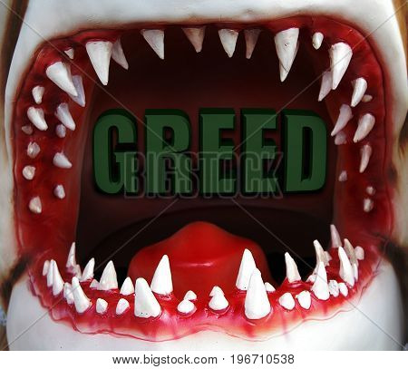 open shark mouth with greed text inside