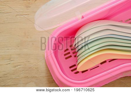 colorful plastic soup spoon in pink box