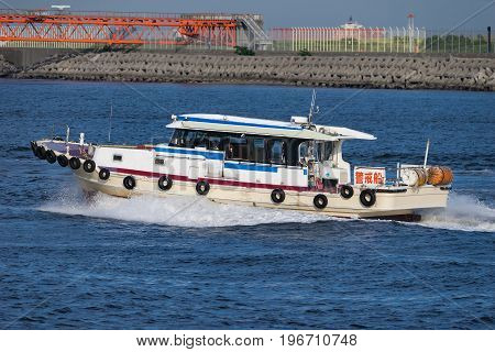 Patrol Boat of Tokyo Bay near Haneda International Airport in Tokyo, Japan. Letters on the ship mean