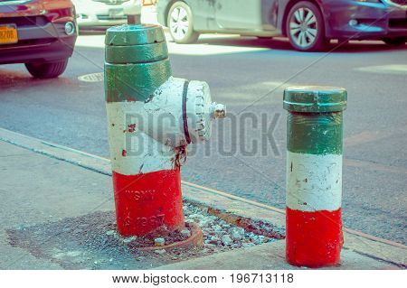 NEW YORK, USA - MAY 05, 2017: The streets of Manhattan New York and specifically the Litle Italy area with a hydrant with the color of the flag of Italy in New York Usa.