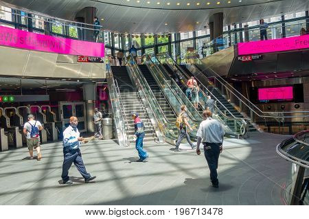 NEW YORK, USA - MAY 05, 2017: Unidentified people walking and enyoing the view, inside of Fulton Center unveiled by Metropolitan Transit Authority during opening ceremony on Broadway in Manhattan.