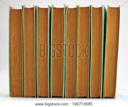 Height Old Books Stacked On White Background