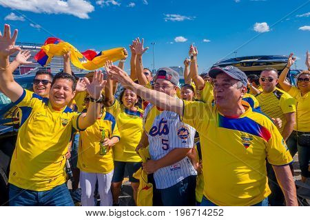 NEW YORK, USA - NOVEMBER 22, 2016: Unidentified ecuadorian fans celebrating the victory of Ecuador outside of Metlife Stadium after football game in New York Usa.