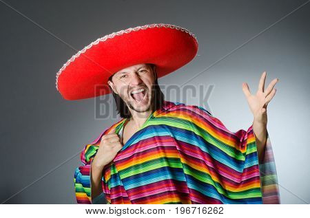 Man in a vivid mexican poncho gray background isolated
