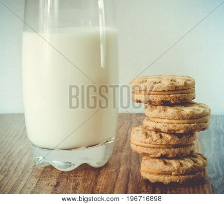 mapple cookies with glass of milk composition