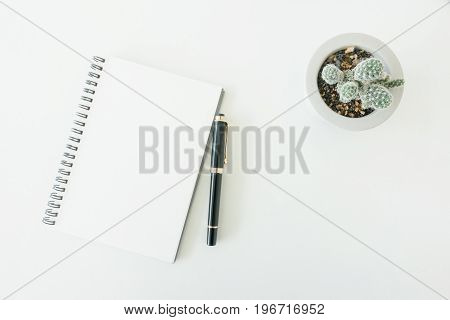 Minimal work space - Creative flat lay photo of workspace desk with sketchbook and wooden pencil on copy space white background. Top view flat lay photography.