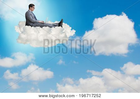 Businessman working on laptop in the sky