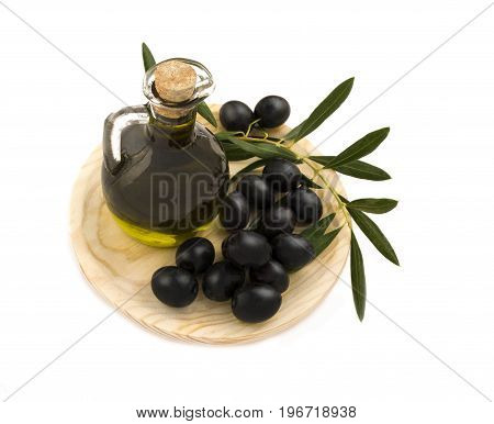 over head shot of a jar of fresh organic oil with picked olives on a wooden plate isolated on a white background