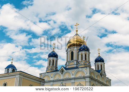 Orthodox crosses on gold and blue domes against blue sky and clouds - Yelets, Russia