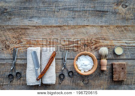 Barbershop. Men's shaving and haircut. Brush, razor, foam, sciccors on wooden table background top view.