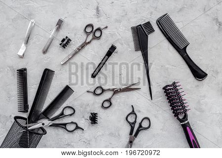 Beauty saloon. Haidressing tools on grey table background top view.